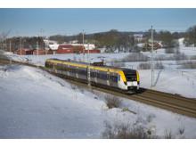 Tåg i vinterlandskap