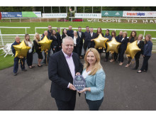 VisitScotland Regional Leadership Director, Jim Clarkson, with Vivien Currie, Chief Executive for Hamilton Park Racecourse, along with staff from the raceourse