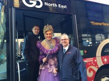 Go North East drivers Paul (r) and Alan with the Fairy Godmother with GNE drivers