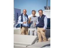 High res image - PMYS - Eddie Jordan with Princess Yachts CEO Antony Sheriff and Chief Operations Officer Paul Mackenzie at the Southampton Boat Show 2019.