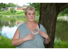 Tatuering som informerar om neuromodulering för smärtlindring