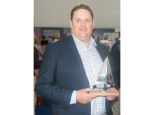 Hi-res image - Ocean Signal - Ocean Signal Sales and Marketing Manager James Hewitt with the Sailing Today Award for Gear Innovation for the rescueME MOB1
