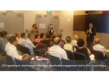 SMRT CEO Desmond Kuek speaking to retail investors during a shareholder engagement visit to Kim Chuan Depot