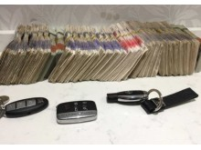Cash and luxury cars seized