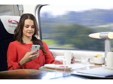 Virgin Trains - Customer using phone - First Class