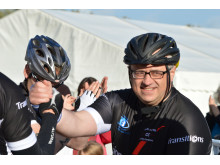 Dean Alldis crosses the finish line of an epic 10-month 5,500-mile cycle challenge