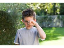 Allergisk rinit - pojke med symtom