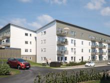 Illustration av de nya fyravåningshusen i området BoKlok Teaken.