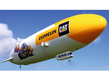 Zeppelinare med hjullastare och logotyp