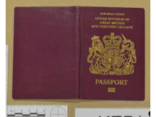Cover of UK passport recovered during the operation.