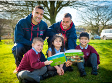 TRY READING: Rochdale Hornets players Sam Teo and Ryan Millard with Whittaker Moss Primary School pupils Harry Dunn, 5, Amina Dar, 6, and Zaci Amid, 5