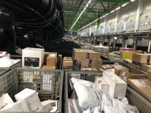 Pakker så langt øyet kan se på Posten og Brings Logistikksenter Oslo i dag