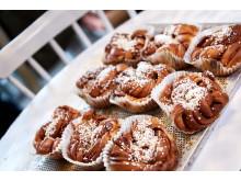 Cinnamon buns on a baking plate - Photo Cred Jonas