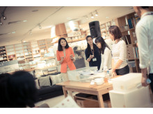 Participants having a contest at Edits Inc's workshop at Muji