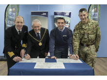 signing Moray's Armed Forces Covenant are (L to R): Capt Chris Smith; Cllr Allan Wright; Gp Capt Paul Godfrey (RAF Lossie station commander); Lt Col Jim Webster (CO 39 Engineer Regt, staion commander Kinloss Barracks)