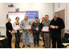 FRYING HIGH: Takeaway owners learn about health improvement from Rochdale Borough Council's Ve Nutter (l) and Clare McNichol (third from r) during National Chip Week
