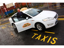 Ready to ride: Taxi driver Keith Watson tries out the new rank