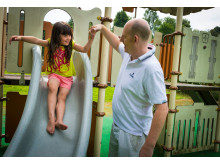 FUN IN THE SUN: Amy Dawson enjoys the slide with her dad at Rochdale Memorial Gardens