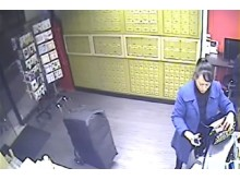 CCTV of Xiou Yu Lin collecting cigarettes LON 04 18