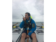 Hi-res image - Ocean Signal - Kyle Smith from Talisker Whisky Atlantic Challenge team Carbon Zerow with his Ocean Signal SafeSea V100 VHF handheld radio