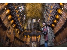 A visitor in the Chapel of the Order of the Thistle, in St Giles' Cathedral, Royal Mile, Edinburgh