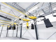 Ved hjælp af en dreven cirkulerende conveyor kan der transporteres op til 10.000 poser i timen