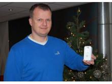 - Bruk en smartkontakt til å stille inn juletrebelysningen