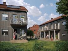 Illustration av de nya husen i BoKlok Krysset i Bålsta, med egna altaner/balkonger samt gröna ytor och naturliga mötesplatser.