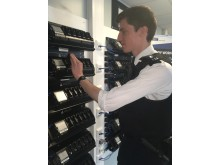 PC Hugh Winchester docking a body worn video camera