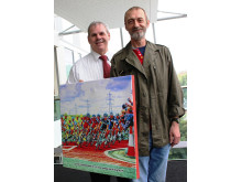 Artist John Cooke presents the picture to Council Leader Richard Farnell.