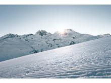 Sonnenaufgang im Skigebiet, Splügen in Graubünden.