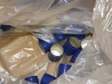 HMRC dismantle fake vodka bottling plant in Aintree, Liverpool - bottle tops