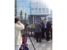 The Chinese film crew prepares to interview acting chief executive Linda Fisher