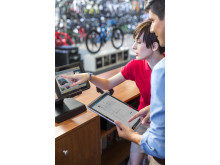 At the POS register in a bicycle shop with HP Pro Slate 12 Tablet and HP MX10 Retail POS Solution