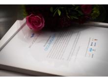 Diplom och blommor