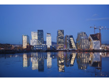 Skyline of Oslo at night reflecting in water