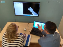 The patient produces movements in a virtual hand