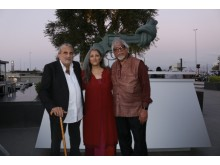 Oct 2nd Non-Violence Day Celebration - Founders Dr. Ogarit Younan and Dr. Walid Slaybi with Arun Gandhi in front of the unveiled knotted gun sculpture Non-Violence.