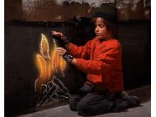 7532116-flames-of-hope-homeless-boy-warming