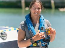 Hi-res image - Ocean Signal - Lia Ditton with the Ocean Signal rescueME PLB1 personal locator beacon