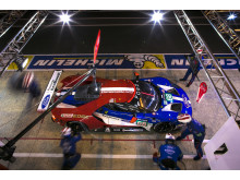 The 68 Ford GT dives into the pits at Le Mans