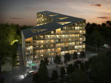 Skymningsbild på Nya Kvibergshuset