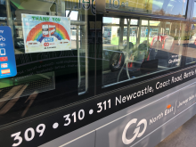 Rainbow poster on a Go North East bus in support of key workers