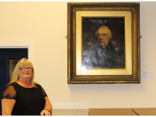 Middleton Township Chair Councillor June West unveils the portrait of Samuel Bamford by Charles Potter