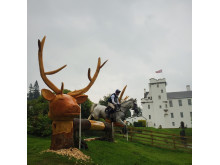 A rider clears a cross-country  jump in front of Blair Castle at the FEI European Eventing Championships.