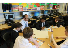 Teacher Mr Smith with S3 pupils at Springburn Academy with the Money Wise textbooks