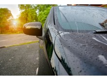 Water droplets evaporating on a car