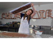 Hayleigh Perks, Scientist Research & Development, gives a demonstration of chocolate tempering