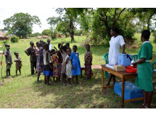 Village children gathering together, to receive their vaccines during an outreach.