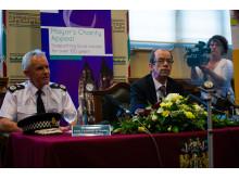Sir Peter Fahy and Cllr Lambert prepare to speak
